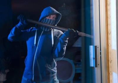 Male breaking into building